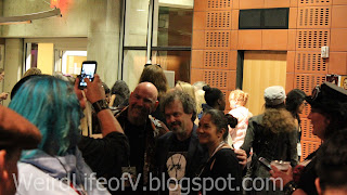Curtis Armstrong taken photos with attendees at the SherlockeDCC party
