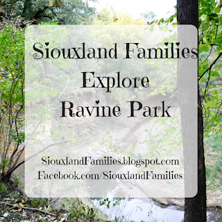 "words ""Siouxland Families Explore Ravine Park"" superimposed on photo of large ravine in a deciduous forest"