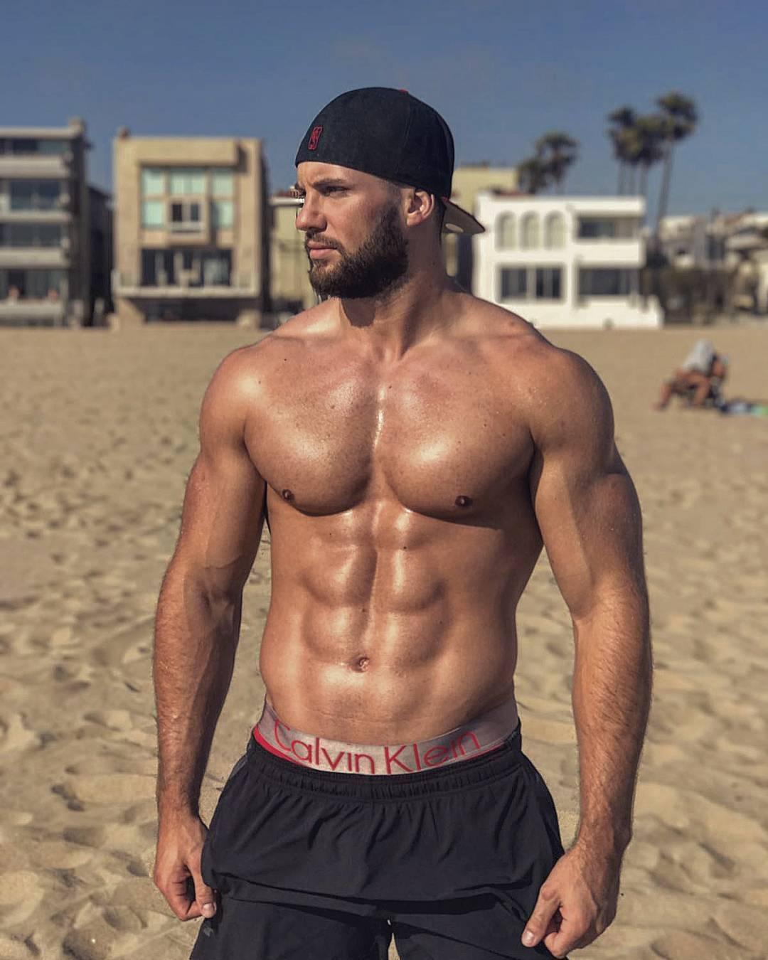 sexy-muscular-shirtless-bad-boys-cap-beard-beach