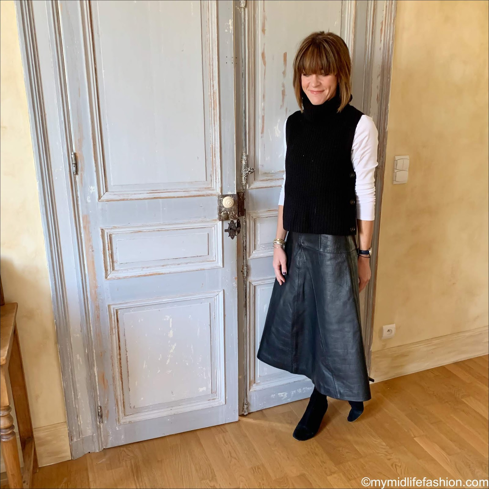 my midlife fashion, Isabel Marant goat suede ankle boots, marks and Spencer long sleeve t shirt, marks and Spencer fit and flare leather midi skirt, arket buttoned wool vest