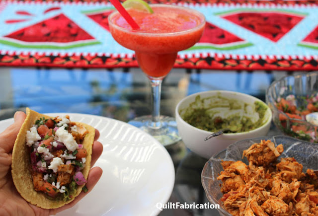 chicken tacos and strawberry watermelon margarita with Watermelon Twist table runner in the background by QuiltFabrication