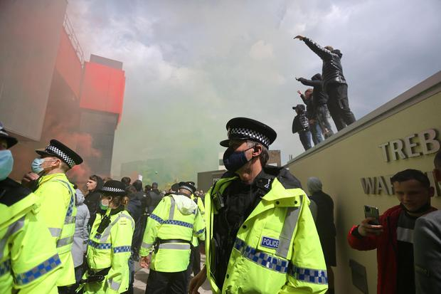 Old Trafford clashes that left police injured were 'unacceptable'