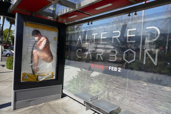 Altered Carbon 3D body sleeve bus shelter installation