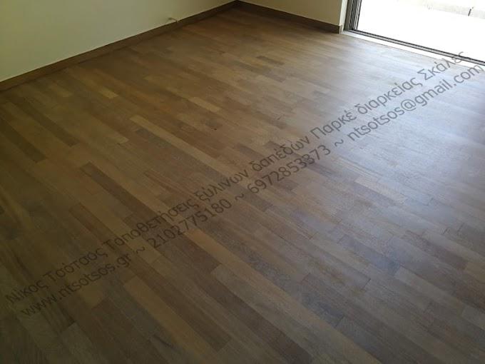 Αλλαγή χρώματος και συντήρηση με ματ βερνίκι σε ιρόκο ξύλινο πάτωμα