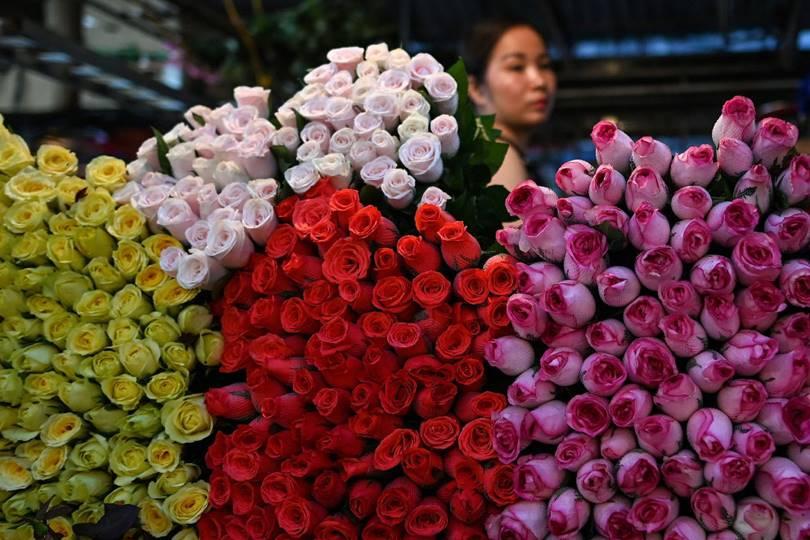 Flower seller in Hanoi. (Photo by Manan Vatsyayana)