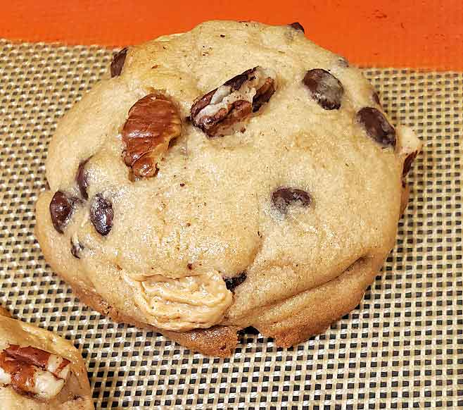 one chocolate chip cookies on a silipat mat