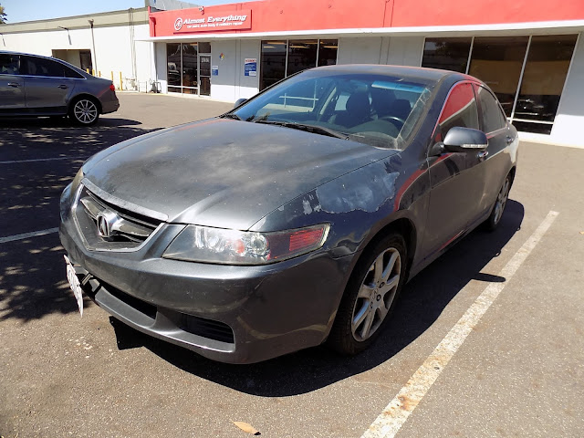 Peeling clear coat on Acura TSX before repainting at Almost Everything Auto Body.