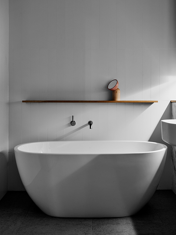 Bathroom, free standing bathtub | Hampton Penthouse. Interior design by Huntly, photo by Brooke Holm
