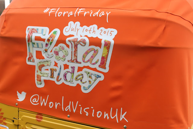 A tuk tuk at RHS Hampton Court flower show advertises World Vision's Floral Friday