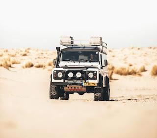 white land rover, sand off roading,desert off roading