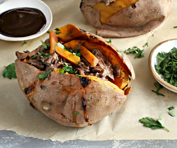 Recipe for tender beef pot roast, shredded and served in roasted sweet potatoes.