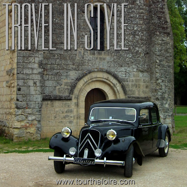 Citroen Traction Avant in front of a chapel in the Loire Valley.  Indre et Loire, France. Photographed by Susan Walter. Tour the Loire Valley with a classic car and a private guide.