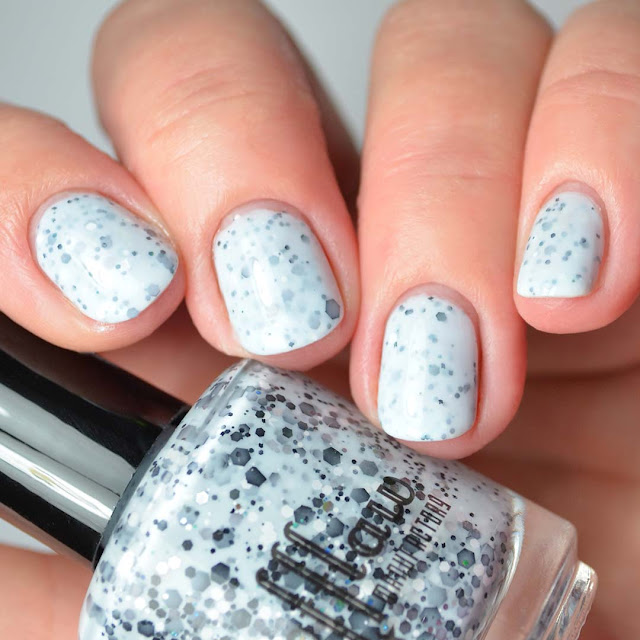 blue nail polish with black glitter four finger swatch