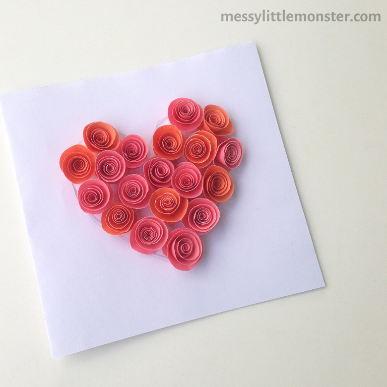 add paper roses to heart shape