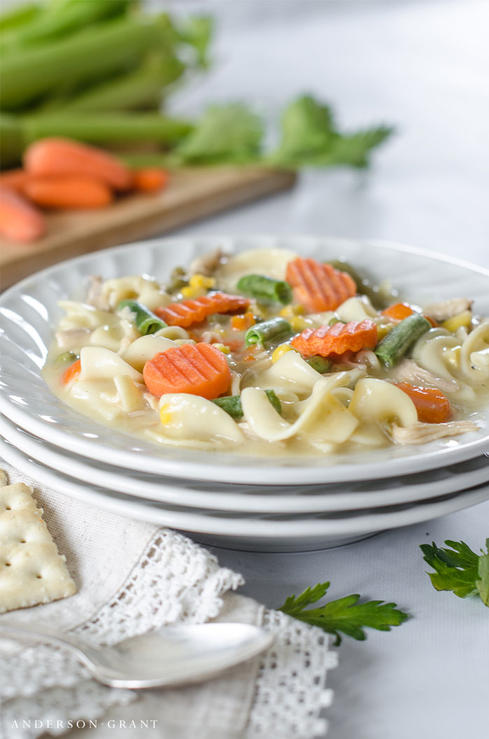 Make this easy Creamy Chicken Noodle Soup with vegetables for supper tonight!  #recipes #slowcooker #crockpot #dinner #soup