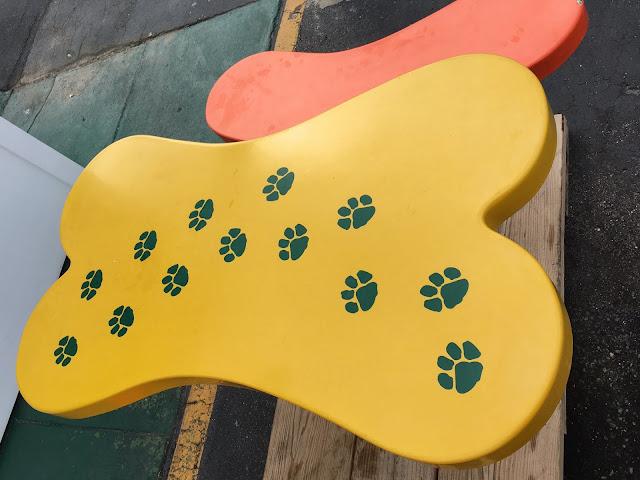 Dog House table, shaped like a dog bone with puppy paw prints