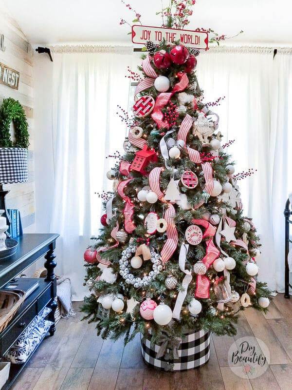 red and white Christmas tree with buffalo check tree collar