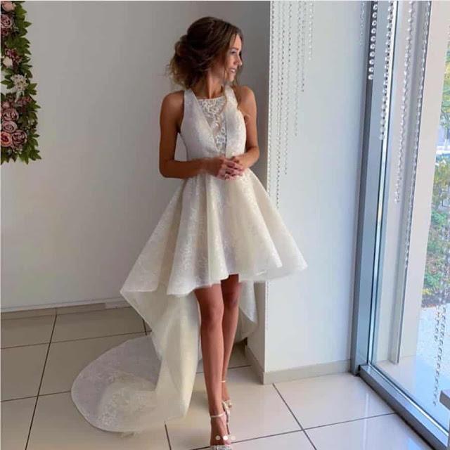 فستان ابيض قصير من الامام وطويل من الخلف بتصميم مميز موديل 2020