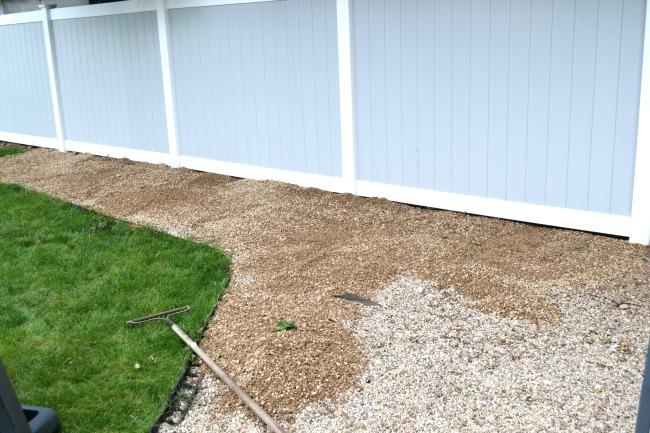 Pea gravel and grassy area