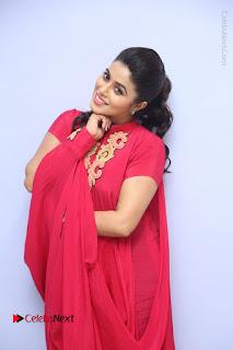 Actress Poorna Latest Stills in Red Dress at Rakshasi First Look Launch  0097.JPG