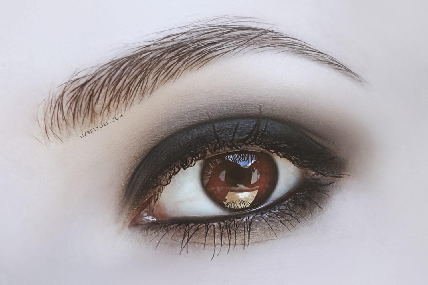 a close-up picture of an eye with smokey eye makeup look