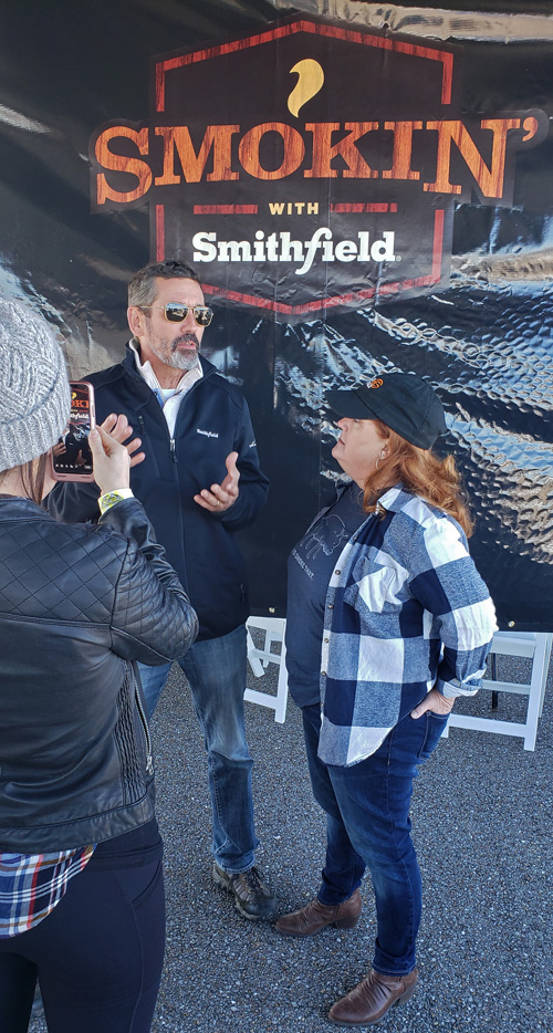 Christie Vanover of Girls Can Grill interviewing legendary pitmaster, Tuffy Stone at 2019 Smokin' with Smithfield National Barbecue Championship