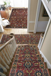 Area rugs line stairways and hallways for comfort & style