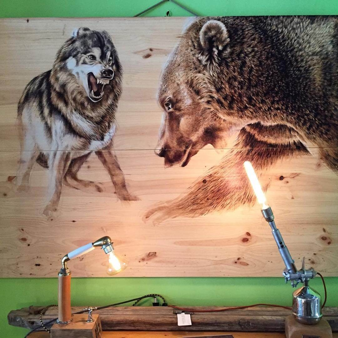 01-The-Wolf-and-the-Bear-Martina-Billi-Animal-Drawings-on-Recycled-Wooden-Planks-www-designstack-co