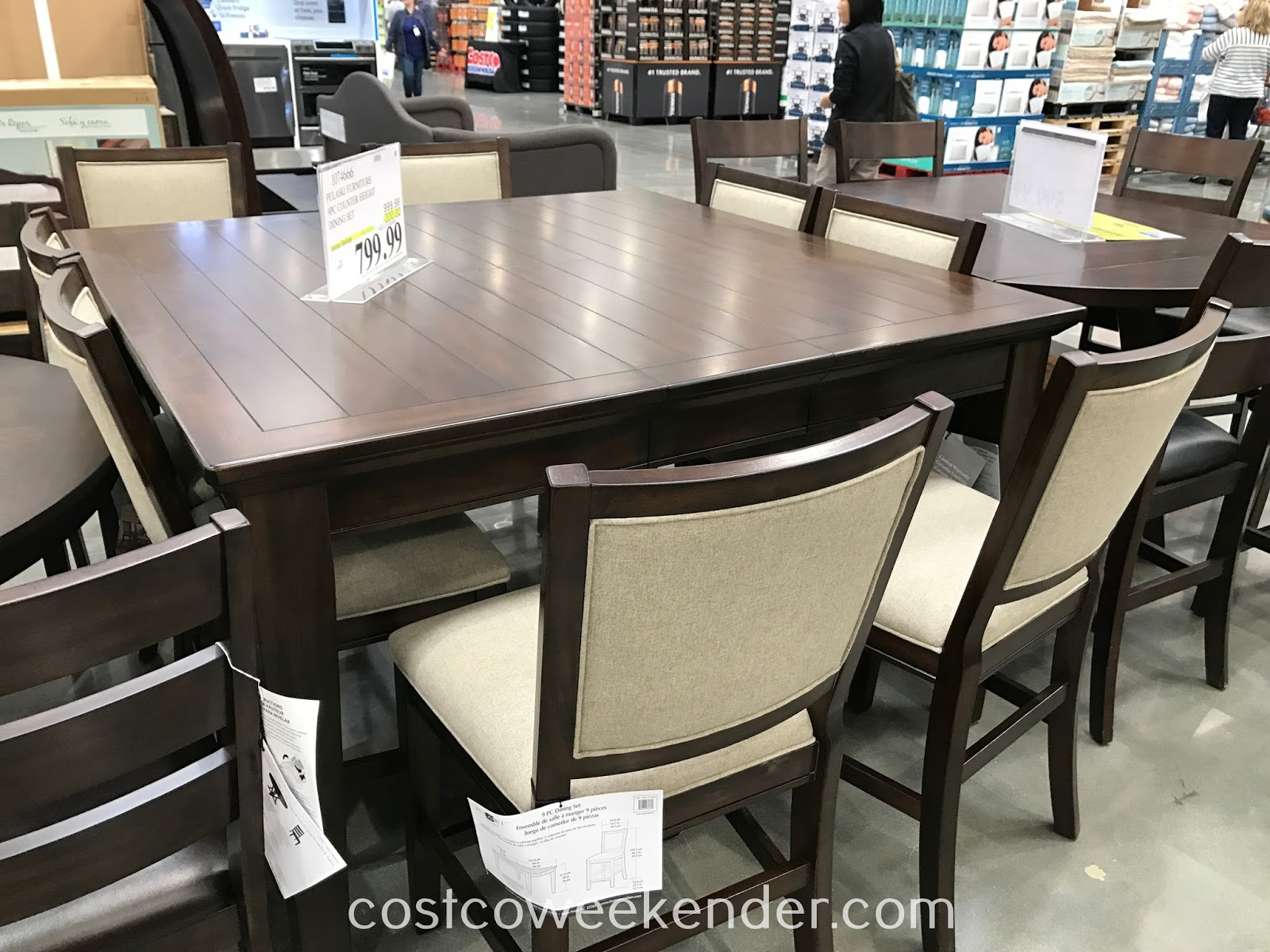 Gather with your family for a meal with the Pulaski Furniture 9pc Dining Set