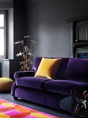 Grey living room design that works well with purple velvet sofa