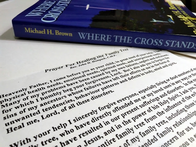 A photo of Michael H. Brown's book, Where the Cross Stands and Fr. John Hampsch's healing prayer