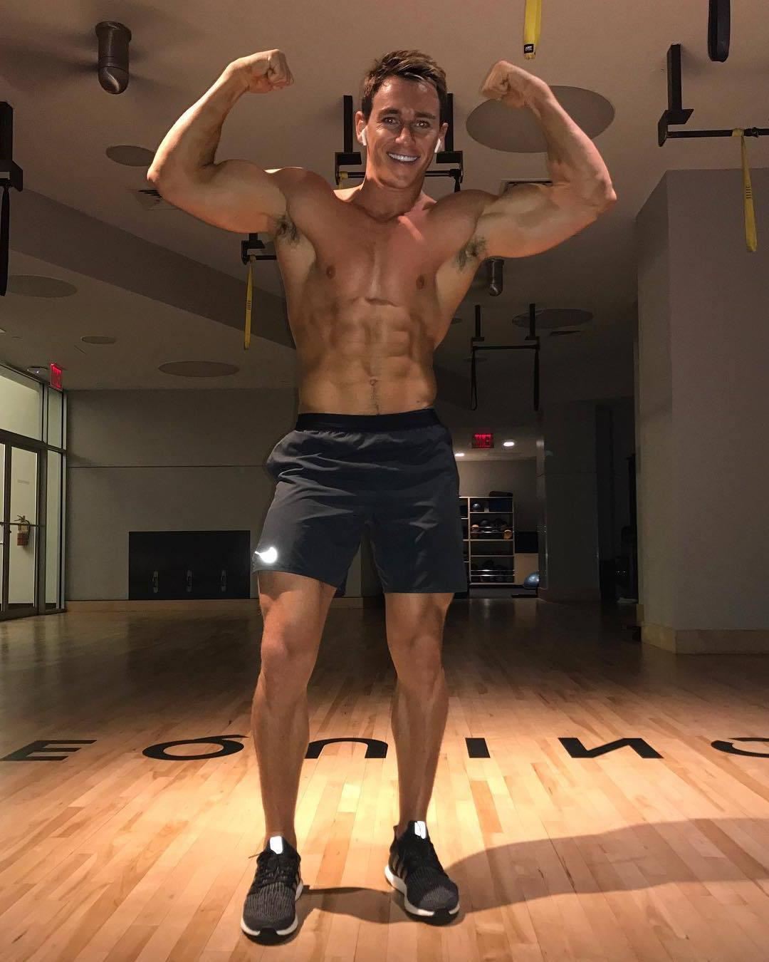 cute-gym-dude-smiling-fit-barechest-body-abs-flexing-biceps