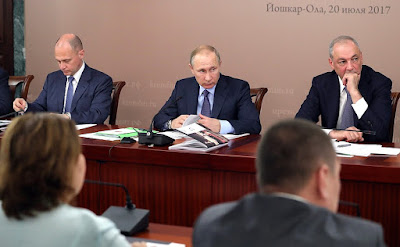 Vladimir Putin at a meeting of the Council for Interethnic Relations. With First Deputy Chief of Staff of the Presidential Executive Office Sergei Kiriyenko (left) and Deputy Chief of Staff of the Presidential Executive Office and Secretary of the Council for Interethnic Relations Magomedsalam Magomedov.