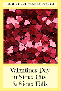 """a pile of red confetti hearts is framed with a light yellow box and below has the words """"Valentine's Day Fun in Sioux City and Sioux Falls"""""""