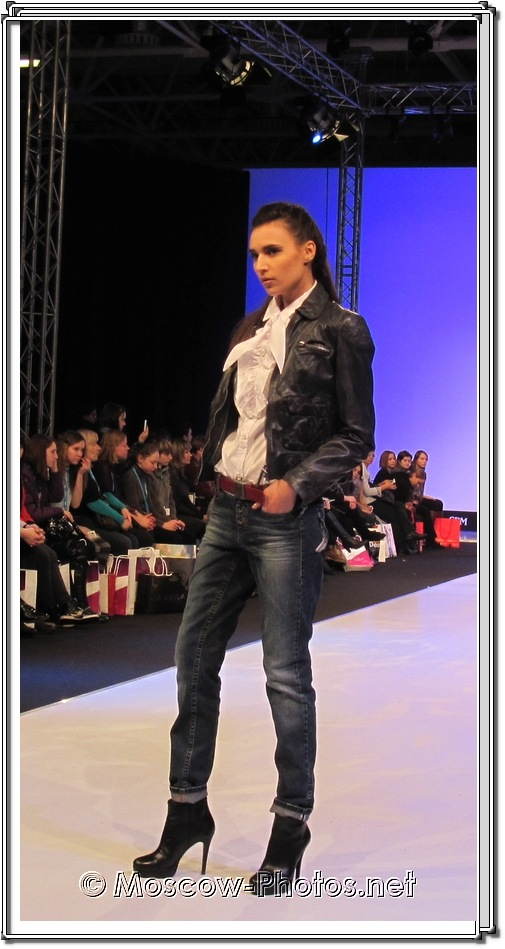 Model in dark blue jeans and black boots. Collection Premiere Moscow 2012.