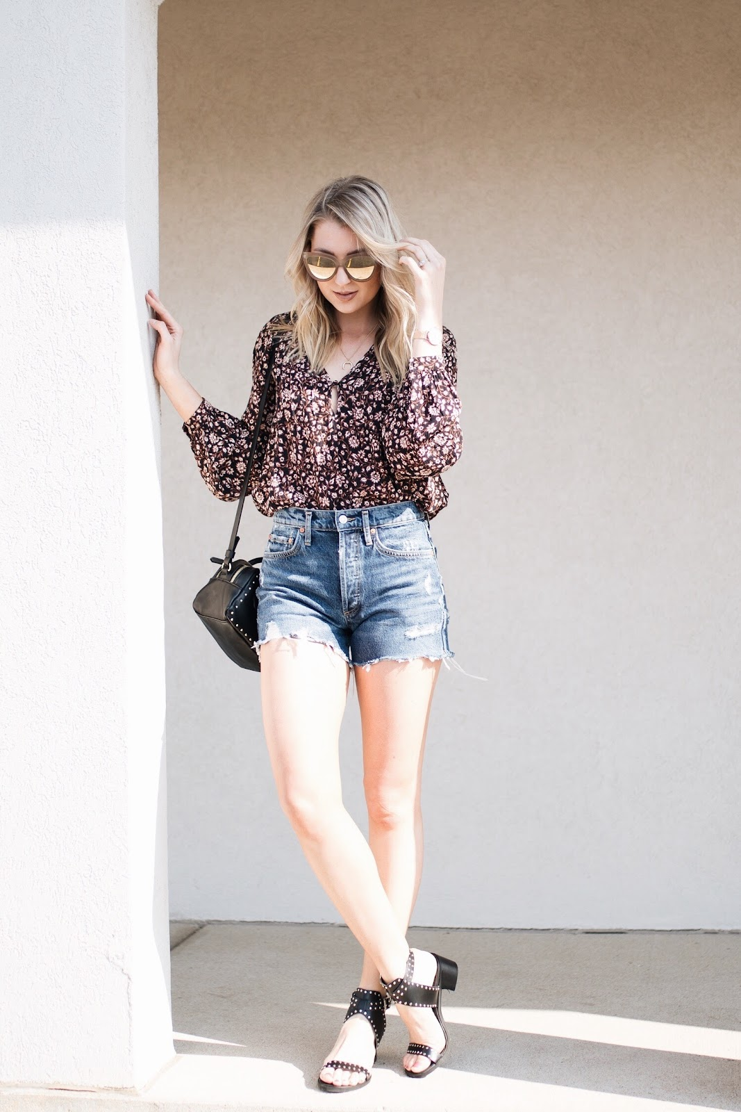 spring outfit idea: cutoffs, floral top, studded sandals