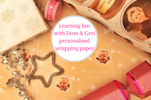 Dom and Geri personalised wrapping paper flatlay with xmas decorations
