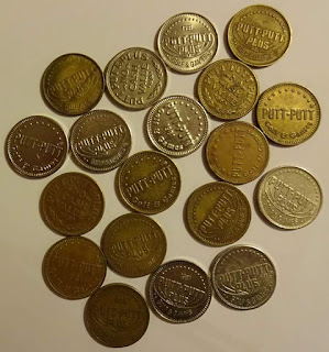 A selection of Putt-Putt tokens