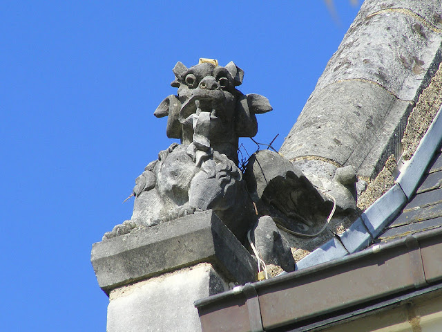 Winged dragon on the Maison du Dauphin, Sainte Catherine de Fierbois, Indre et Loire, France. Photo by Loire Valley Time Travel.