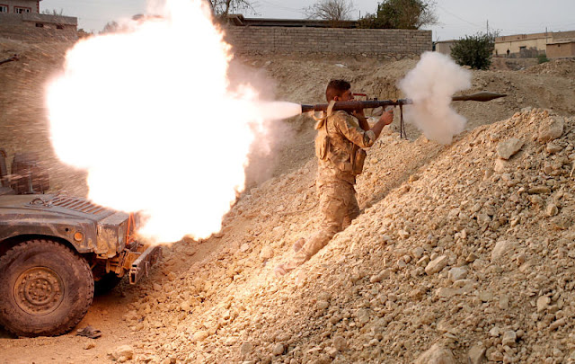 Image Attribute: An Iraqi soldier fires an RPG in Karamah, south of Mosul, Iraq November 10, 2016.        REUTERS/Goran Tomasevic/File Photo