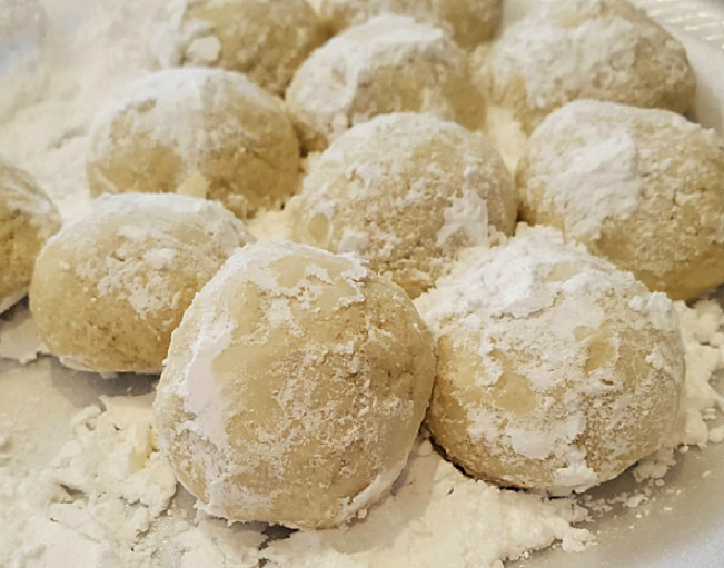 these are butterballs cookies rolled in powdered sugar they look like snowballs