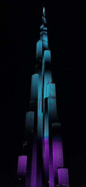 Burj khalifa green and purple light illustration wallpaper