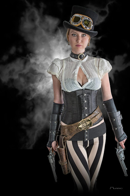 women's steampunk clothing in black and white. white blouse, black corset, black top hat, goggles, gloves, bracers, belt with holster and black and white stripped pants (leggings)