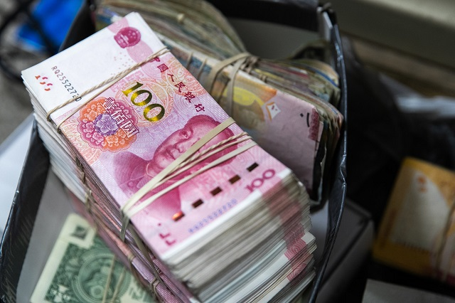 How much money does the world owe China?
