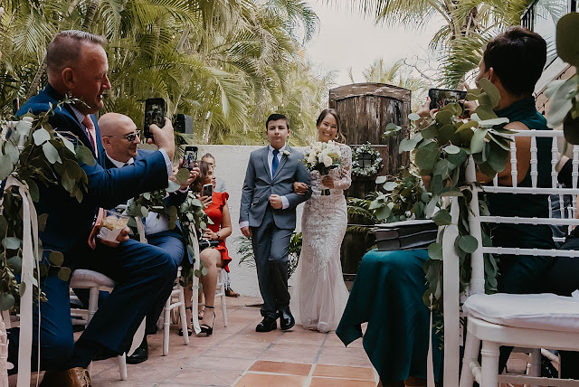 Bride entering Ceremony and attendees taking pictures The Manor on St Lucie Crescent Wedding captured by Stuart Wedding Photographer Heather Houghton Photography