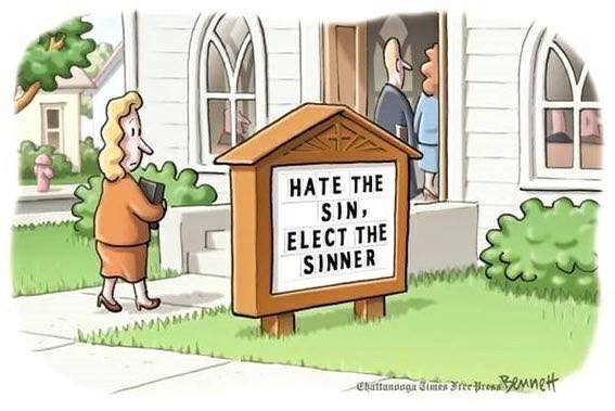 Woman entering Evangelical church reading the sign in front of it, which reads