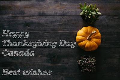 Happy Thanksgiving Day Canada written wooden background.