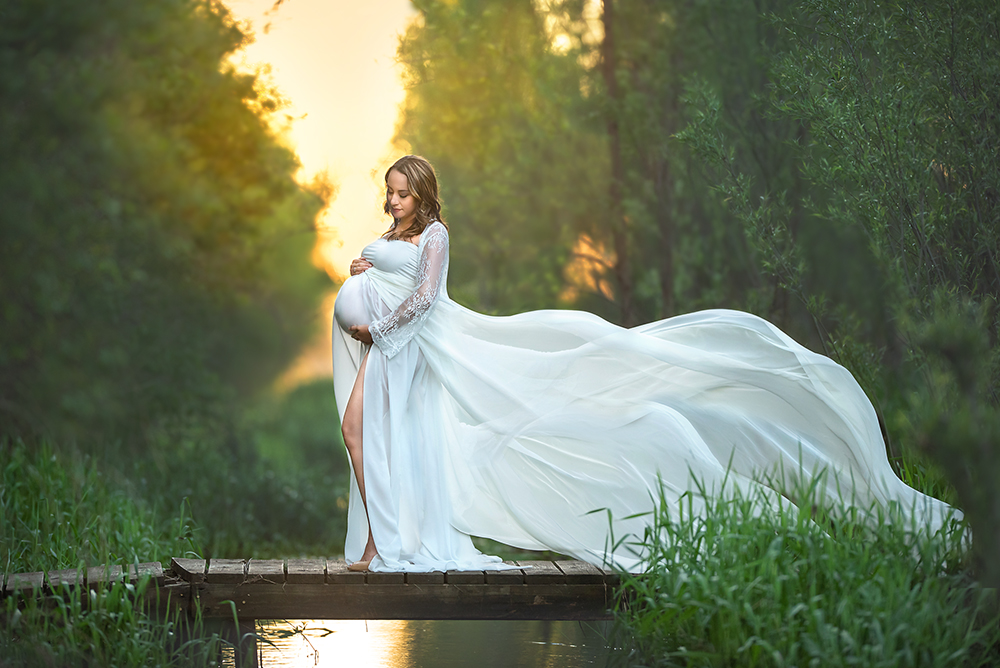 Beautiful outdoor maternity session with white lace dress with train