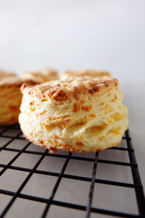 baked cheese buttermilk biscuit cooling on rack