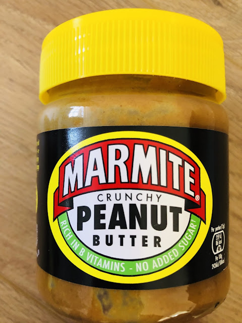 Marmite Crunchy Peanut Butter in jar with yellow lid.